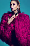 Fashion stylish swag model in fur coat Royalty Free Stock Photography