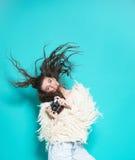 Fashion stylish woman dancing and making photo Royalty Free Stock Photos