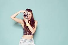 Fashion stylish woman dancing and making photo Royalty Free Stock Image
