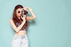 Fashion stylish woman dancing and making photo Stock Photo