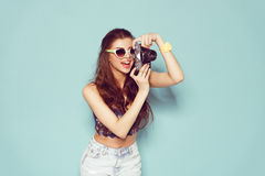 Fashion stylish woman dancing and making photo Royalty Free Stock Photography