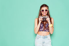 Fashion stylish woman dancing and making photo stock photos