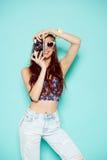 Fashion stylish woman dancing and making photo Stock Image