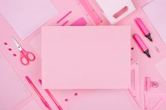 Fashion stylish workplace - blank paper for text on neon pink office stationery collection on pastel background, top view. Fashion stylish workplace - blank stock photography