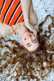 Fashion summer is a bright portrait of a young beautiful woman with long hair and colorful clothes stock photos