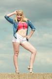 Fashion summer joyful girl against sky Stock Photos