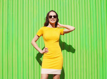 Fashion summer portrait of beautiful young woman in yellow dress Royalty Free Stock Image