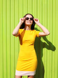 Fashion summer sunny portrait of beautiful young woman in yellow Royalty Free Stock Image