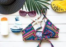 Fashion summer swimsuit bikini, sunglasses and big hat on rope. Summer bikini and accessories stylish outfit beach set. Ocean sea Stock Photo
