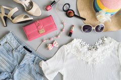 Fashion summer women clothes set with cosmetics and accessories. Flat lay, Top view Stock Images