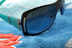 Fashion sunglasses on a beach towel Stock Photography