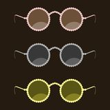 Fashion sunglasses with a rim of round beads Stock Photos