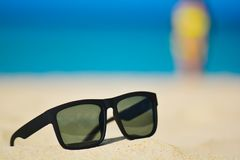 Fashion sunglasses on sea beach. Summer holiday relax background with copy space.  Stock Images