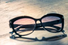 Fashion sunglasses on wooden table royalty free stock photos