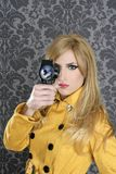 Fashion Super 8mm camera reporter woman vintage. Wallpaper yellow coat stock photography