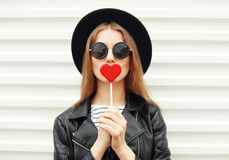 Fashion sweet woman having fun with lollipop over white stock photography