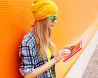Fashion and technology concept - stylish pretty cool girl Stock Images