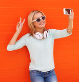 Fashion, technology and people concept - smiling pretty girl Stock Photos