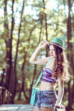 Fashion teen girl with hat and purse Stock Image