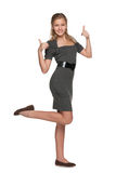 Fashion teen girl with her thumbs up Royalty Free Stock Photos