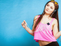 Fashion teen girl listen music mp3 relax happy and dancing Royalty Free Stock Photos