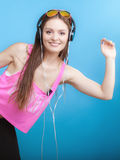 Fashion teen girl listen music mp3 relax happy and dancing Stock Photography