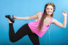 Fashion teen girl listen music mp3 relax happy and dancing Royalty Free Stock Images