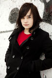Fashion teen girl at white graffiti background Stock Images