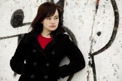 Fashion teen girl at white graffiti background Stock Image