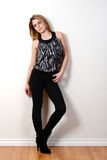 Fashion teen model leaning on wall. Portrait of a fashion teen model leaning on wall Stock Photos