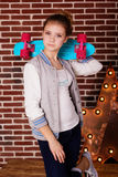 Fashion teenager girl is holding blue skateboard Stock Images