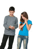 Fashion teenagers with a cell phone royalty free stock photos