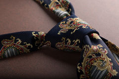 Fashion tie knot on table. Elegant casual fashion neck tie knot on table Royalty Free Stock Photography