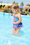 Fashion toddler in the pool Royalty Free Stock Photography