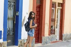 Fashion tourist woman on the street in Italy. Young tourist woman on the main street in Italy Royalty Free Stock Image