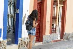 Fashion tourist woman on the street in Italy. Young tourist woman on the main street in Italy Stock Photos