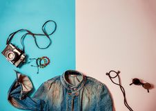 Fashion and travel pop art style flat. Fashion female items flatlay, top view to retro camera, jeans jacket, headphones and sunglasses. Pop art concept Royalty Free Stock Photo