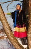 Fashion tree. Girl is climbing on the tree Royalty Free Stock Photography