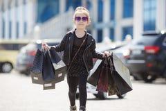Cute little caucasian girl child having shopping fun. royalty free stock photo