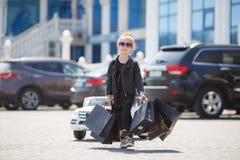 Cute little caucasian girl child having shopping fun. stock photos