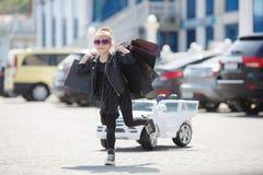Cute little caucasian girl child having shopping fun. stock photography