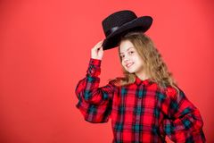Fashion trend. Feeling awesome in this hat. Girl cute kid wear fashionable hat. Small fashionista. Cool cutie. Fashionable outfit. Happy childhood. Kids fashion royalty free stock photo