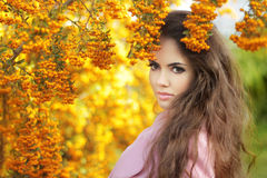 Fashion trendy beauty girl autumn portrait. Brunette woman over Stock Photos