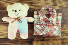 Fashion trendy look of baby boy and toy stuff. Fashion trendy look of baby boy and toy on the wooden floor, baby fashion concept, Top view Stock Photography