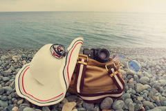 Fashion trendy photo of hat, retro camera, sun glasses and bag o royalty free stock photography