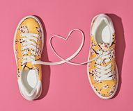 Fashion Trendy Trainers with Heart. Valentines day. Fashion Trendy Trainers with Heart. Woman Set. Pastel Pink Color. Minimal Style. Summer Floral Sneakers. Flat Stock Photos