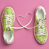 Fashion Trendy Trainers with Heart. Valentines day. Fashion Trendy Trainers with Heart. Woman Set. Pastel Pink Color. Minimal Style. Summer Floral Sneakers. Flat Royalty Free Stock Image