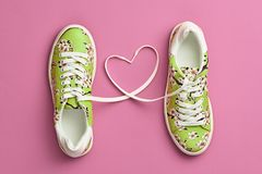 Fashion Trendy Trainers with Heart. Valentines day. Fashion Trendy Trainers with Heart. Woman Set. Pastel Pink Color. Minimal Style. Summer Floral Sneakers. Flat Stock Photography