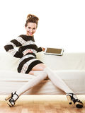 Fashion trendy woman with tablet at home Royalty Free Stock Photos