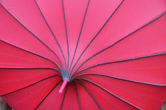 Red fashion umbrella. Design simple and clear, strong fashion sense of the sun umbrella close-up Royalty Free Stock Photography